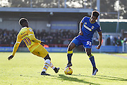 AFC Wimbledon striker Lyle Taylor (33) and Millwall midfielder Fred Onyedinma (10) during the EFL Sky Bet League 1 match between AFC Wimbledon and Millwall at the Cherry Red Records Stadium, Kingston, England on 2 January 2017. Photo by Stuart Butcher.