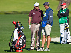 February 14, 2010; Pebble Beach, CA, USA;  Phil Mickelson talks to his caddy Jim Mackay on the second hole during the final round of the AT&T Pebble Beach Pro-Am at Pebble Beach Golf Links.