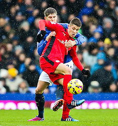 Andrej Kramaric of Leicester City is closed down by Everton's John Stones  - Photo mandatory by-line: Matt McNulty/JMP - Mobile: 07966 386802 - 22/02/2015 - SPORT - Football -  - Goodison Park - Everton v Leicester City - Barclays Premier League