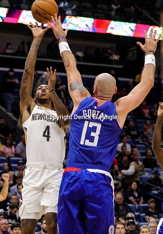 Oct 23, 2018; New Orleans, LA, USA; New Orleans Pelicans guard Elfrid Payton (4) shoots over Los Angeles Clippers center Marcin Gortat (13) during the first quarter at the Smoothie King Center. Mandatory Credit: Derick E. Hingle-USA TODAY Sports