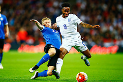 Raheem Sterling of England is tackled by Taijo Teniste of Estonia - Mandatory byline: Jason Brown/JMP - 07966 386802 - 09/10/2015- FOOTBALL - Wembley Stadium - London, England - England v Estonia - Euro 2016 Qualifying - Group E