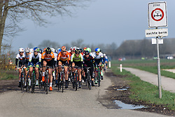 The peloton approach - Energiewacht Tour 2016 - Stage 4a. A 75 km road race starting and finishing in Zuidhorn, Netherlands on April 9th 2016.