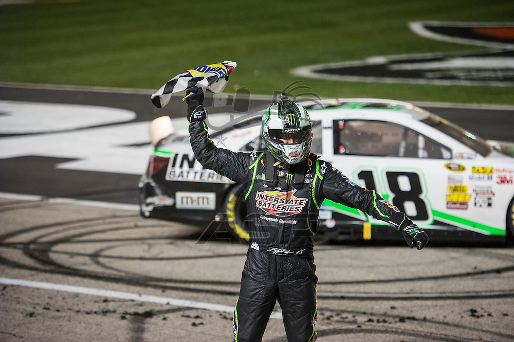 Fort Worth, TX - APR 13, 2013: Kyle Busch (18) wins the NRA 500 at the Texas Motor Speedway in Fort Worth, TX.