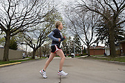 "New treatments have helped Emily Schaller, a 27-year-old cystic fibrosis patient, from Trenton, MI, recently run a half marathon. She prepares to go running on Tuesday, April 21, 2009. She also wears her ""smart vest,"" which shakes her chest to help break up mucous in her lungs and inhales from her nebulizer. She wears the vest for 25 minutes at least once every day. She inhales Pulmozyme for 7 minutes once and inhales hyper-tonic saline (salt water) twice every day."