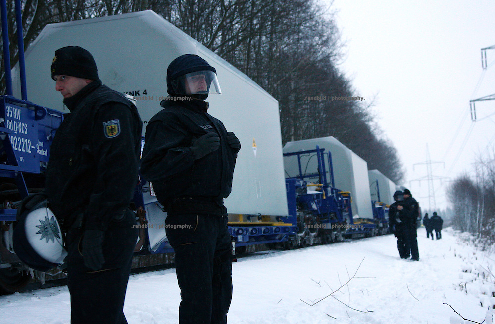 """Hundreds of people demonstrated near Lubmin (north eastern Germany) against an upcomming nuclear waste transport to storage facility """"Zwischenlager Nord"""" in Lubmin. 300 activists have blocked the tracks and were cleared by police later. 2 activists of """"Robin Wood"""" locked themselves in a concrete block placed within the track bed near Dietrichshagen and stopped the transport for 6 houres. The protest has taken place shortly after the governments unpopular decision to extend the period of operation for german nuclear power plants for an additional decade."""