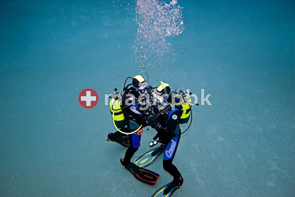 Diver Joel SPIRIG (R) and Olivier FORNARO (L) of Switzerland are dancing during a PADI scuba diving training lesson in the outdoor pool in Gossau, ZH, Switzerland, Monday, May 26, 2008. (Photo by Patrick B. Kraemer / MAGICPBK)