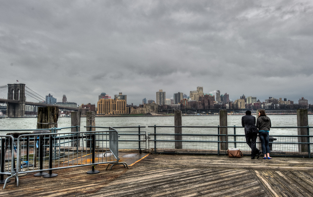 Couple enjoying the view from Pier 17 in Manhattan