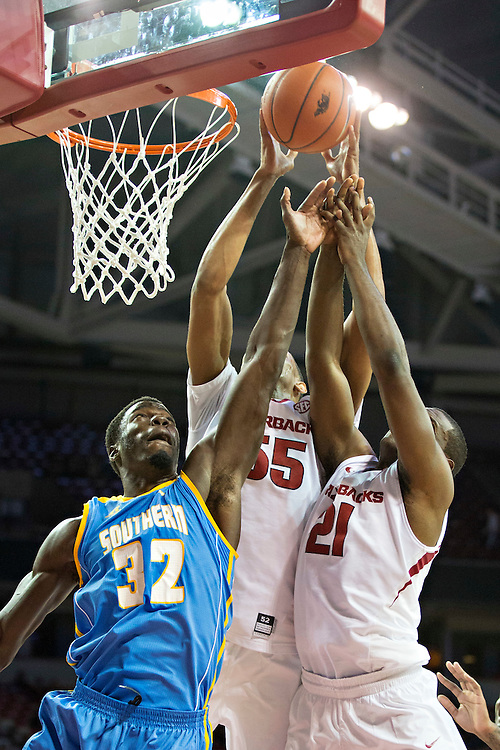 FAYETTEVILLE, AR - NOVEMBER 13:  Keaton Miles #55 and Manuale Watkins #21 of the Arkansas Razorbacks goes up for a rebound against D'Arian Allen #32 of the Southern University Jaguars at Bud Walton Arena on November 13, 2015 in Fayetteville, Arkansas.  The Razorbacks defeated the Jaguars 86-68.  (Photo by Wesley Hitt/Getty Images) *** Local Caption *** Keaton Miles; Manuale Watkins; D'Arian Allen
