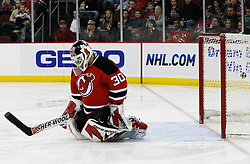 Jan 22, 2010; Newark, NJ, USA; Montreal Canadiens left wing Mathieu Darche (52) scores a goal on New Jersey Devils goalie Martin Brodeur (30) during the second period at the Prudential Center.