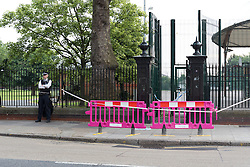 © Licensed to London News Pictures. 22/07/2016. LONDON, UK.  A police officer stands at the cordon around West Ham Lane Recreational Ground, known as Stratford Park on West Ham Lane in Stratford, where a man in his 20's was stabbed and killed yesterday afternoon. Two men were arrested nearby on suspicion of murder and taken into custody at an east London police station. Photo credit: Vickie Flores/LNP