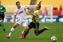 Adelaide United's Karim Matmour , left, leaves the Phoenix's Goran Paracki on the back foot in the A-League football match at Westpac Stadium, Wellington, New Zealand, Sunday, October 08, 2017. Credit:SNPA / Dean Pemberton **NO ARCHIVING**