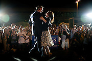 Republican presidential candidate Michele Bachmann dances with her husband, Marcus,  at a rally at Iowa State, the site of the Straw Poll in Ames, Iowa, August 12, 2011.