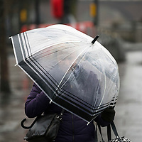 A lady attempts to shelter herself from the wind and rain with her umbrella on Perth's Tay Street as another spell of bad weather hits the country from Eastern Europe…16.03.18<br />