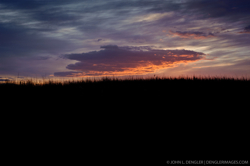 Prairie grass is silhouetted against a dramatic fall sunrise at the Tallgrass Prairie National Preserve. The 10,894-acre Tallgrass Prairie National Preserve is located in the Flint Hills of Kansas in Chase County near the towns of Strong City and Cottonwood Falls. Less than four percent of the original 140 million acres of tallgrass prairie remains in North America. Most of the remaining tallgrass prairie is in the Flint Hills in Kansas. Tallgrass Prairie National Preserve is the only unit of the National Park Service dedicated to the preservation of the tallgrass prairie ecosystem. The Tallgrass Prairie National Preserve is co-managed with The Nature Conservancy. silhouetted against a dramatic fall sunrise at the Tallgrass Prairie National Preserve. The 10,894-acre Tallgrass Prairie National Preserve is located in the Flint Hills of Kansas in Chase County near the towns of Strong City and Cottonwood Falls. Less than four percent of the original 140 million acres of tallgrass prairie remains in North America. Most of the remaining tallgrass prairie is in the Flint Hills in Kansas. Tallgrass Prairie National Preserve is the only unit of the National Park Service dedicated to the preservation of the tallgrass prairie ecosystem. The Tallgrass Prairie National Preserve is co-managed with The Nature Conservancy.