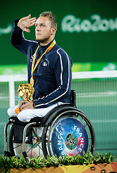 Stephane Houdet (out of frame) and Nicolas Peifer of France celebrate at Victory ceremony after winning against Alfie Hewett (out of frame) and Gordon Reid (out of frame) of the UK in the Tennis Men's Doubles Gold Medal Match during Day 8 of the Rio 2016 Summer Paralympics Games on September 15, 2016 in Olympic Tennis Centre, Rio de Janeiro, Brazil. Photo by Vid Ponikvar / Sportida