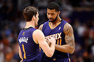 Nov 15, 2013; Phoenix, AZ, USA; Phoenix Suns forward Markieff Morris (11) walks with guard Goran Dragic (1) on the court against the Brooklyn Nets at US Airways Center. The Nets defeated the Suns 100-98 in overtime. Mandatory Credit: Jennifer Stewart-USA TODAY Sports