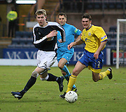Dens Park, Dundee<br /> Dundee's Kevin McDonald goes past Queen of the South's Neil McFarlane