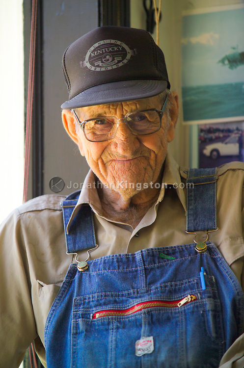 FLOYD, VA,  Earl Harmon relaxes in the window of the barbershop in Floyd, Virginia.  He often makes a daily stop at the shop to visit with friends and shoot the breeze.