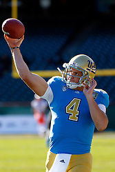 Dec 31, 2011; San Francisco CA, USA;  UCLA Bruins quarterback Kevin Prince (4) warms up before the game against the Illinois Fighting Illini at AT&T Park.  Mandatory Credit: Jason O. Watson-US PRESSWIRE