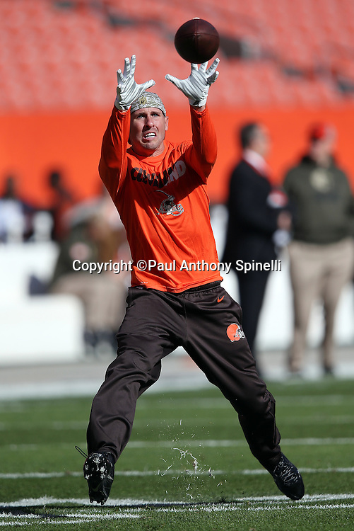Cleveland Browns wide receiver Brian Hartline (83) catches a pass while warming up before the 2015 week 8 regular season NFL football game against the Arizona Cardinals on Sunday, Nov. 1, 2015 in Cleveland. The Cardinals won the game 34-20. (©Paul Anthony Spinelli)