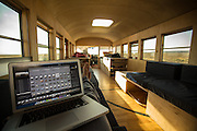 """Architecture Student Converts Old Bus into Comfy Mobile Home Complete with Repurposed Gym Floor<br /> <br /> For his final project at architecture school, Hank Butitta remodeled an old school bus he bought on Craigslist into a modern, comfortable living space. Now he and pal Justin Evidon are on a 5,000-mile journey to see how it holds up.<br /> <br /> Sleeping on an old school bus doesn't sound like fun until you check out Hank Butitta's tricked-out mobile home.<br /> Stripped of its grubby seats, the bus — purchased as a fixer-upper for $3,000 on Craigslist — is now equipped with beds, tables, storage and social areas, and a working sink and toilet. The 225-square-foot space can comfortably sleep six, the 27-year-old architect<br /> <br /> """"It's turned out to be the ultimate road trip vehicle,"""" said Butitta, who's in the midst of a 5,000-mile cross-country journey to """"test"""" the bus, which was his final project at the University of Minnesota's School of Architecture.<br /> """"A week before I was starting my final semester, I had no idea what I was going to do for my master's thesis and I impulsively bought a school bus, and hoped I could make something of it,"""" said Butitta, who graduated in May.<br /> <br /> <br /> He had also grown frustrated with designing projects that only existed on paper — Butitta wanted to create something that could be used in real life.<br /> His spontaneity worked.<br /> <br /> The bus project, which took 15 weeks to complete, won a critic's choice award from the school and spawned the blog, """"Hank Bought a Bus,"""" where fans follow Butitta and pal Justin Evidon, a photographer who runs the website.<br /> <br /> So far, they've stopped at national parks and friends' places in Seattle, Portland and San Francisco — picking up and dropping off friends along the way. Next up are Denver and Kansas City.<br /> <br /> The pair will finish their journey where they started it: in Minneapolis.<br /> <br /> """"You couldn't throw any six people on the bus, """