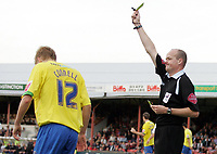 Photo: Paul Thomas.<br /> Grimsby Town v Hereford United. Coca Cola League 2. 08/10/2006.<br /> <br /> Alan Connell (L) of Hereford is yellow carded after he scores a goal with his hands by Referee Mr L S Mason.