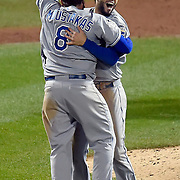 Kansas City Royals first baseman Eric Hosmer and third baseman Mike Moustakas celebrate after the Royals defeated the New York Met 7-2 to win the World Series on Sunday, November 1, 2015 at Citi Field in New York.