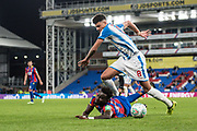Crystal Palace #23 Pape Souare, Huddersfield Town (8)Philip Billing during the EFL Cup match between Crystal Palace and Huddersfield Town at Selhurst Park, London, England on 19 September 2017. Photo by Sebastian Frej.