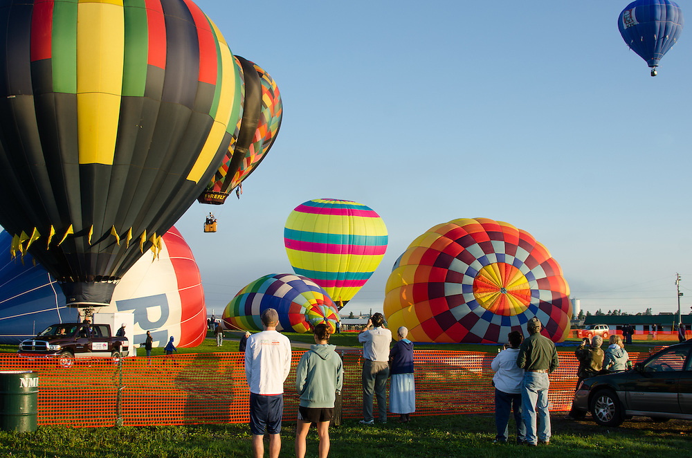 Early risers watch a morning launch at the Crown of Maine Balloon Fair, Presque Isle, Maine.
