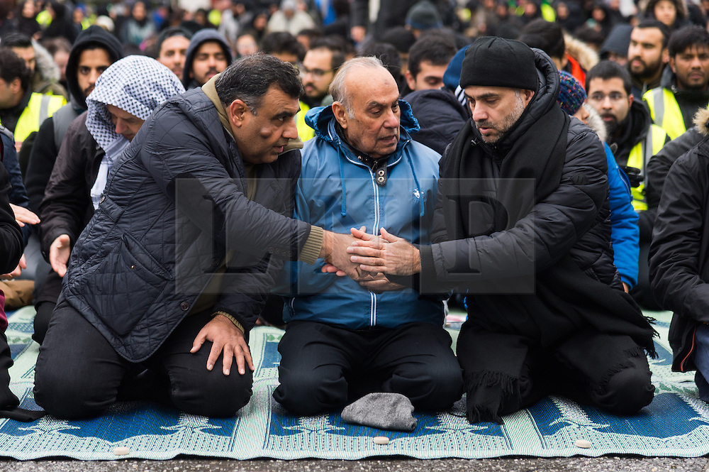 CAPTION CORRECTION © Licensed to London News Pictures. 20/11/2016. Muslim men pray before taking part in the annual Arbaeen procession,  which marks a sacred Shia Muslim ritual. Arbaeen, also known as Chehlum, commemorates the end of the 40-day mourning period after the killing of Imam Hussein, the Prophet Muhammad's grandson, in a battle in 680 AD. His martyrdom is considered a defining event in the schism between Sunni and Shia Muslims. London, UK. Photo credit: Ray Tang/LNP