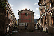 A damaged building in the historical center city. On 6 April 2009 a strong earthquake hit the city of L'Aquila, in the central Abruzzo region of Italy, leaving 308 dead and tens of thousand homeless. 4  years after In the historical center of the city few signs of reconstructions could be seen. On the other hand the effects of the of abandonment add up to the destruction of the quake. .