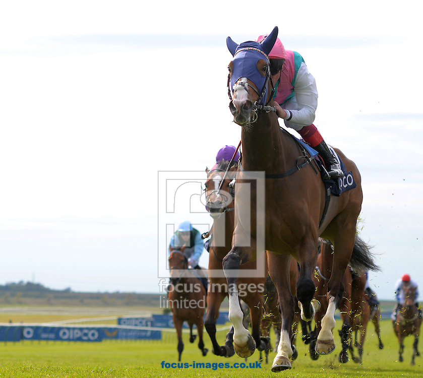 Swiss Range ridden by Frankie Dettori (green, white sleeves, pink cap) wins Tweenhills Pretty Polly stakes during the QIPCO Guineas Festival  on the  Newmarket Rowley Mile Course, Newmarket, UK.<br /> Picture by Martin Lynch/Focus Images Ltd 07501333150<br /> 01/05/2016