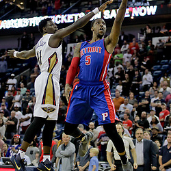 Mar 1, 2017; New Orleans, LA, USA; Detroit Pistons guard Kentavious Caldwell-Pope (5) shoots over New Orleans Pelicans guard Jrue Holiday (11) during the first quarter of a game at the Smoothie King Center. Mandatory Credit: Derick E. Hingle-USA TODAY Sports