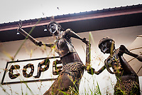 The entrance to the COPE visitor's center. COPE (Cooperative Orthotic & Prosthetic Enterprise) helps give artificial limbs and assistance to landmine and UXO victims in Laos. The sculpture in the foreground is made from old war remnants by local Lao artist Anousone VongAphay.