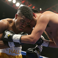 "Marcus Hall (yellow shorts) defeats Rafael Luna during the undercard match of the ESPN ""Boxcino"" boxing tournament at Turning Stone Resort Casino on Friday, April 18, 2014 in Verona, New York.  (AP Photo/Alex Menendez)"