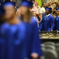 Students make their way to their seats as Friday's Tupelo High School graduatin starts.
