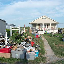August 4, 2017 - Tangier Island, VA - A homeowners flooded possessions are left out to dry on Tangier Island.<br /> Photo by Susana Raab/Institute