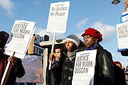 Vigil held for Mark Duggan outside Tottenham police station after a jury returned a verdict of 'lawful killing'.<br /> <br /> Duggan was shot by police in August 2011 prompting rioting across the UK.<br /> <br /> Tottenham, London, UK.<br /> January 11th 2013<br /> <br /> Picture by Zute Lightfoot