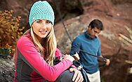 Jenna Hughes sits at the base of a crag while on a rock climbing adventure in Boulder, Colorado.