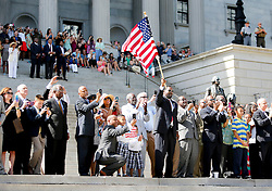 "Lawmakers and their families stand on the State House steps to watch as members of the South Carolina Highway Patrol honor guard take down the Confederate battle flag Friday, July 10, 2015 at the State House in Columbia. zlaup ""Confederate Flag"""