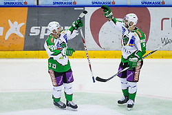 John Hughes (HDD Tilia Olimpija, #72) and Scot Hotham (HDD Tilia Olimpija, #5) celebrate during of ice-hockey match between Moser Medical Graz 99ers and HDD Tilia Olimpija in 11th Round of EBEL league, on October 14, 2011 at Eisstadion Graz-Liebenau, Graz, Austria. (Photo By Matic Klansek Velej / Sportida)