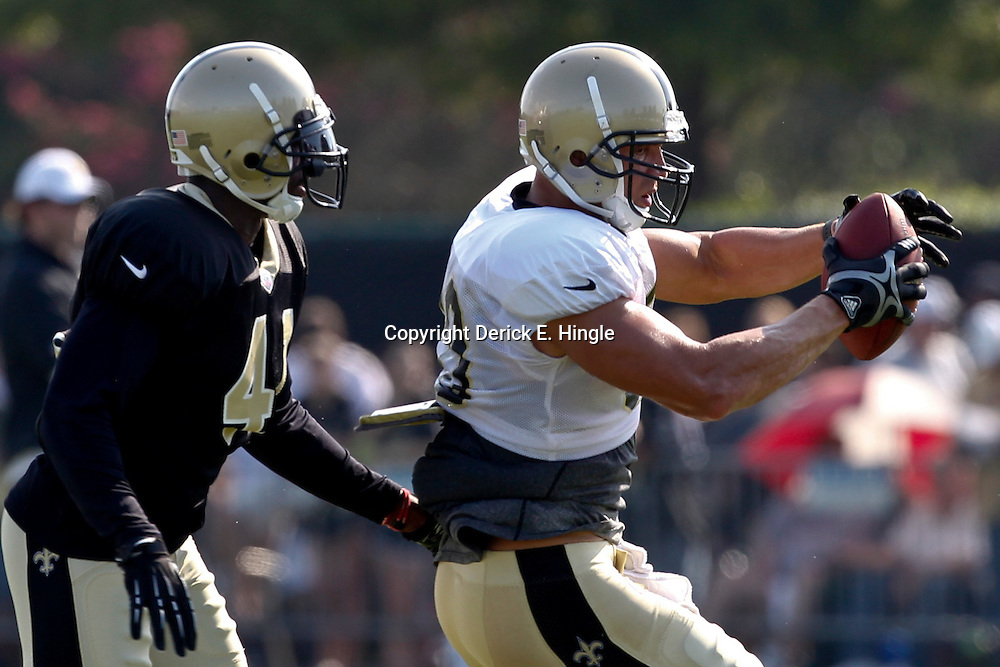 July 29, 2012; Metairie, LA, USA; New Orleans Saints tight end Jimmy Graham (80) catches a pass in front of safety Roman Harper (41) during a training camp practice at the team's practice facility. Mandatory Credit: Derick E. Hingle-US PRESSWIRE