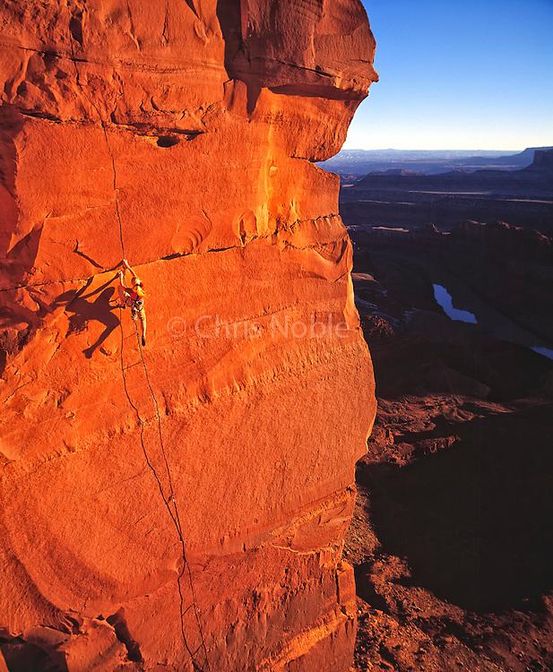 Lisa Hathaway climbing on the cliffs above Canyonlands National Park, Southern Utah