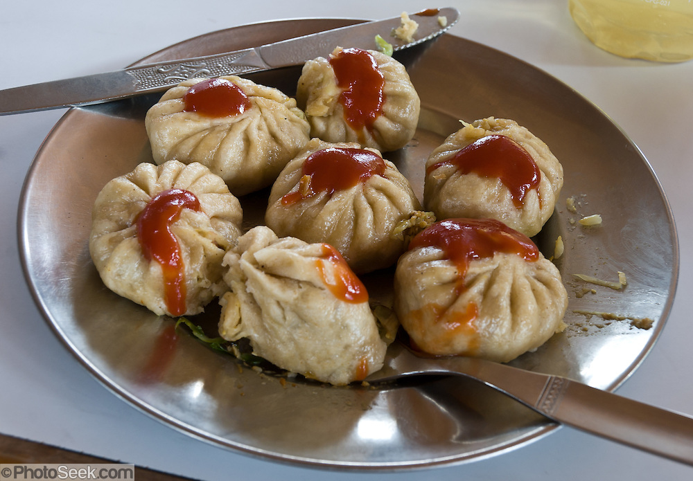 Momos are Tibetan steamed or fried dumplings. This food dish is commonly available for meals in trekker teahouses in Nepal.