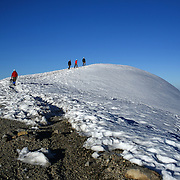 Climbers make their way to the top of Columbia Crest, the highest point of Mount Rainier at 14,411 feet during a summit of Mount Rainier on June 30, 2015. The iconic Pacific Northwest volcano is a popular challenge for mountaineers.  (Joshua Trujillo, seattlepi.com)