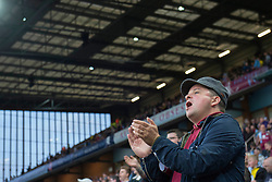 An Aston Villa fan cheers on his team - Mandatory byline: Dougie Allward/JMP - 07966386802 - 14/08/2015 - FOOTBALL - Villa Park -Birmingham,England - Aston Villa v Manchester United - Barclays Premier League
