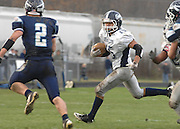 John Glenn's Devin McCulloh (15) looks for running room outside around Petoskey's Quinn Ameel (2) during the Bobcat's playoff loss to Petoskey Saturday.