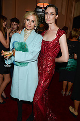 Left to right, LAURA BAILEY and ERIN O'CONNOR at a private view of fashion art by David Downton as in-house artist at Caridge's , held at Claridge's Hotel, London on 13th September 2013.