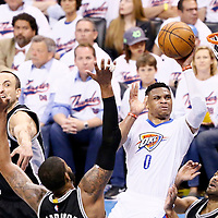 06 May 2016: Oklahoma City Thunder guard Russell Westbrook (0) takes a jump shot over San Antonio Spurs forward LaMarcus Aldridge (12) and San Antonio Spurs guard Tony Parker (9) during the San Antonio Spurs 100-96 victory over the Oklahoma City Thunder, during Game Three of the Western Conference Semifinals of the NBA Playoffs at the Chesapeake Energy Arena, Oklahoma City, Oklahoma, USA.