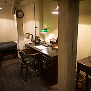 Sir Edward Bridge's room at the Churchill War Rooms in London. The museum, one of five branches of the Imerial War Museums, preserves the World War II underground command bunker used by British Prime Minister Winston Churchill. Its cramped quarters were constructed from a converting a storage basement in the Treasury Building in Whitehall, London. Being underground, and under an unusually sturdy building, the Cabinet War Rooms were afforded some protection from the bombs falling above during the Blitz.